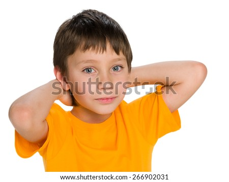 A portrait of a cute little boy dreams against the white background