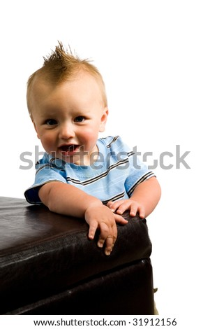 A portrait of a cute nine month old baby boy isolated on a while background.