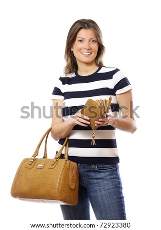 A portrait of a fashionable woman with a nice bag and open wallet over white background