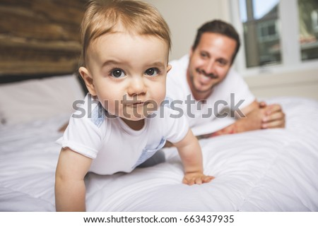 Shutterstock A Portrait of a father with her nine months old baby