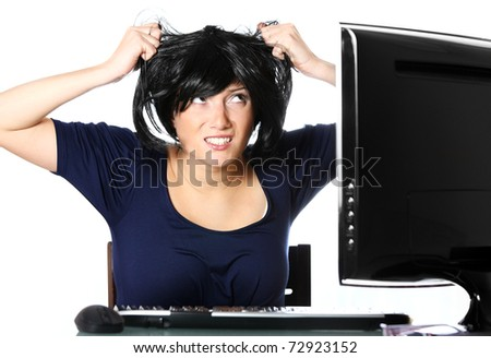 A portrait of a frustrated young businesswoman pulling out hair over white background