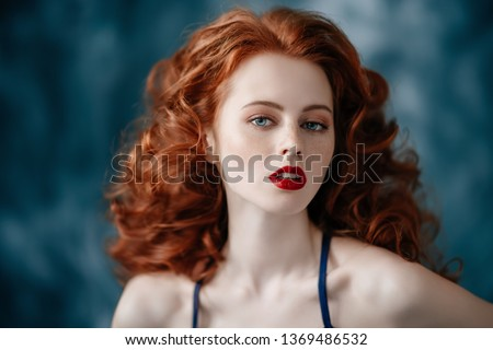 A portrait of a gorgeous beautiful young woman posing in the studio. Beauty, cosmetics. #1369486532