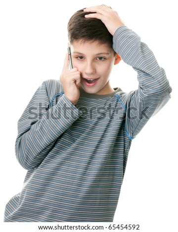 A portrait of a handsome boy talking on the mobile phone; isolated on the white background