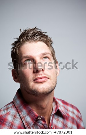 A portrait of a handsome caucasian man looking up