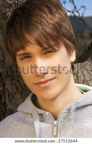 portrait of a handsome teen boy outside. - stock photo