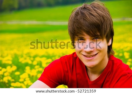 portrait of a handsome teen boy outside - stock photo