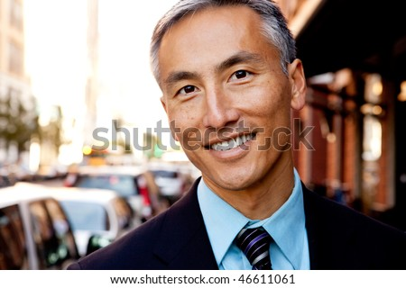 A portrait of a happy asian looking business man