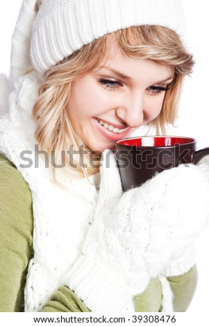 A portrait of a happy beautiful caucasian winter woman holding a coffee cup