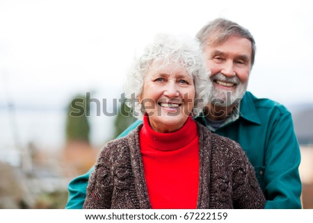 A portrait of a happy senior couple - stock photo