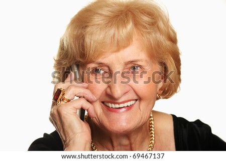 A portrait of a happy senior lady talking on the phone against white background