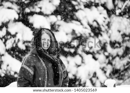 A portrait of a happy woman in a snowy wintery Colorado, USA