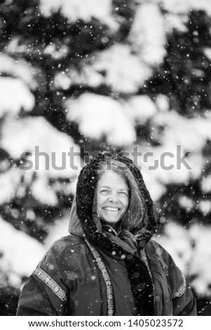 A portrait of a happy woman in a snowy wintery Colorado, USA