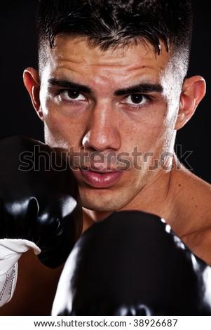 A portrait of a hispanic male boxer
