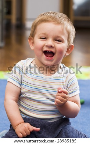 A portrait of a laughing happy child