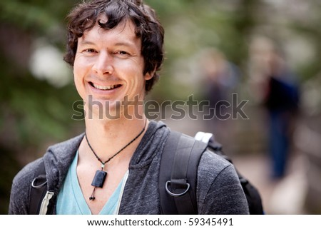 A portrait of a man outdoor on a hike - stock photo