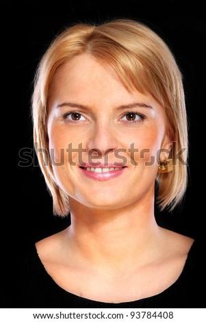 A portrait of a mature elegant woman smiling over black background