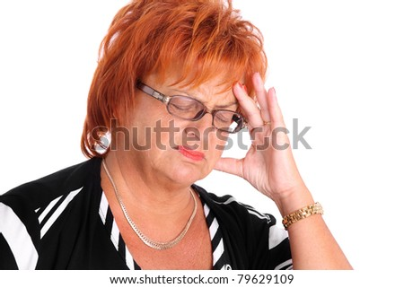 A portrait of a middle-aged lady having headache over white background