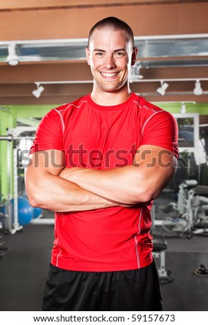 A portrait of a muscular caucasian athlete in a gym
