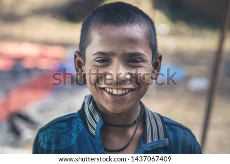 A portrait of a poor innocent Indian boy from a village #1437067409
