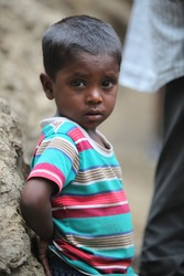 A portrait of a poor little boy from India in his unfortunate condition.