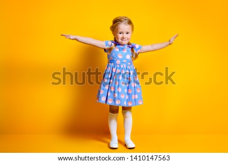 A portrait of a positive young pretty girl. Summer bright fashion for kids. #1410147563