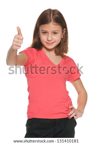 A portrait of a pretty girl in a red blouse holds her thumb up