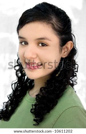 a portrait of a pretty hispanic teenage