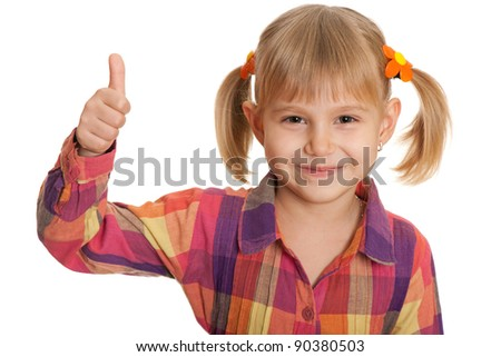A portrait of a pretty little girl holding her thumb up; isolated on the white background