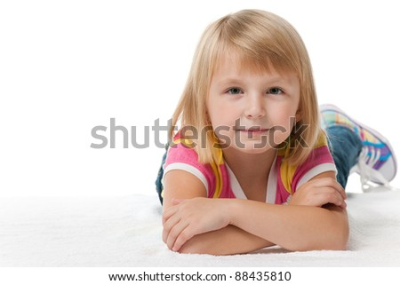 A portrait of a pretty thoughtful little girl; isolated on the white background