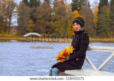 A portrait of a pretty young woman with autumn leaves