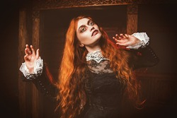 A portrait of a redhead woman in an old wooden castle. Magic, dark force, spell.