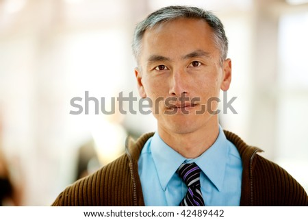 A portrait of a semi casual business man with colleagues in the background