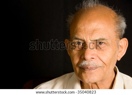 A portrait of a senior Indian man