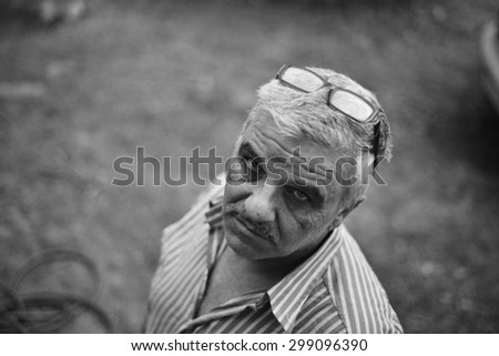 A portrait of a senior man looking up. Monochrome picture