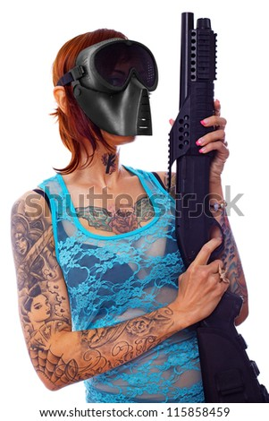 A portrait of a sexy young punk girl armed with a shotgun - stock photo