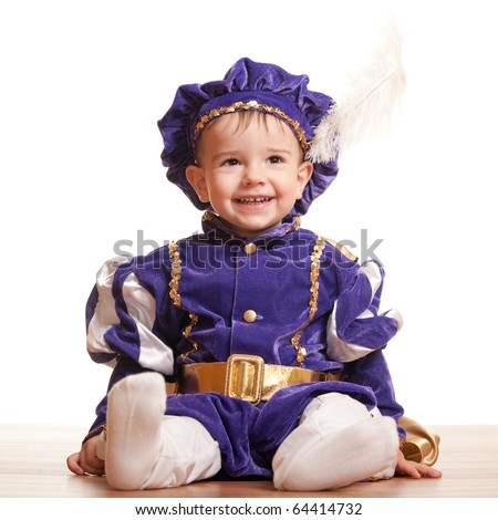 A portrait of a sitting little boy in a carnival suit of prince; isolated on the white background