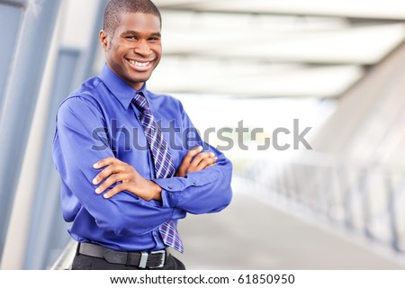 A portrait of a smiling black businessman outdoor - stock photo
