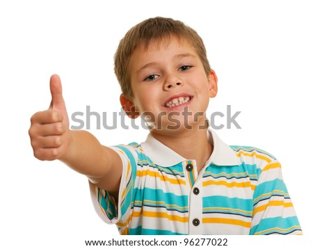 A portrait of a smiling boy holding his thumb up; isolated on the white background