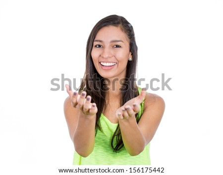 A portrait of a smiling happy teenager excited girl with raised up palms arms at you isolated over white background concept of freedom and happy student young pretty woman asking us to give a hug