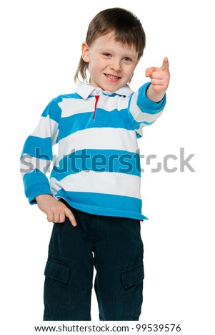 A portrait of a smiling little boy pointing forward; isolated on the white background