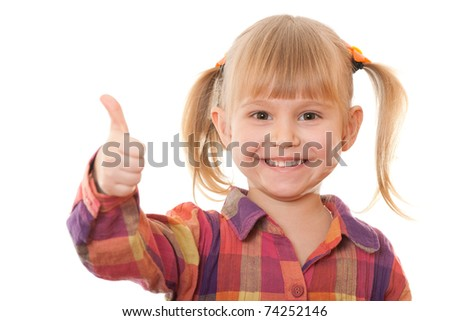 A portrait of a smiling pretty girl holding her thumb up; isolated on the white background