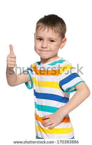 A portrait of a smiling young boy holding his thumb up on the white
