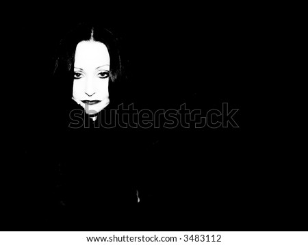 A portrait of a striking older woman on black.