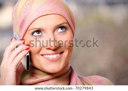 A portrait of a successful arabic woman talking on the cell phone