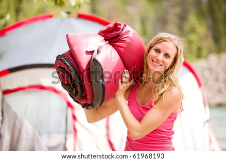 A portrait of a woman holding a sleeping bag