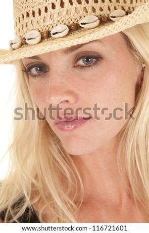 A portrait of a woman in a cowboy hat.  She has a serious expression on her face.