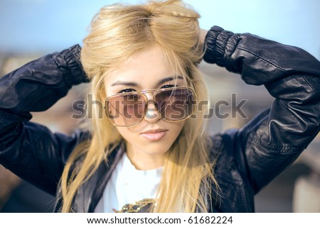 a portrait of a woman with a sun-glasses