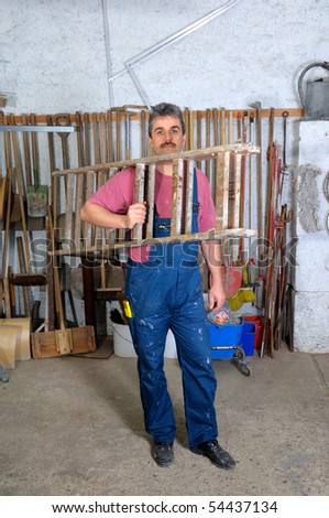 a portrait of a workman in his workshop