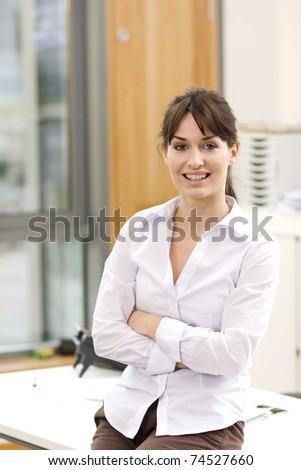 A portrait of a young business woman in an office