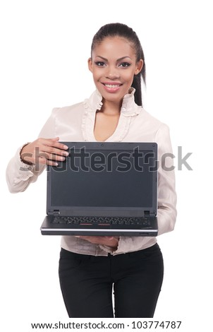 A portrait of a young business woman with laptop